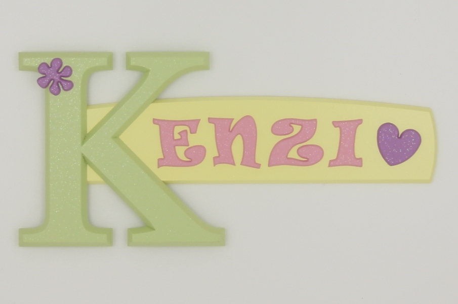 painted wooden name sign for Kenzi