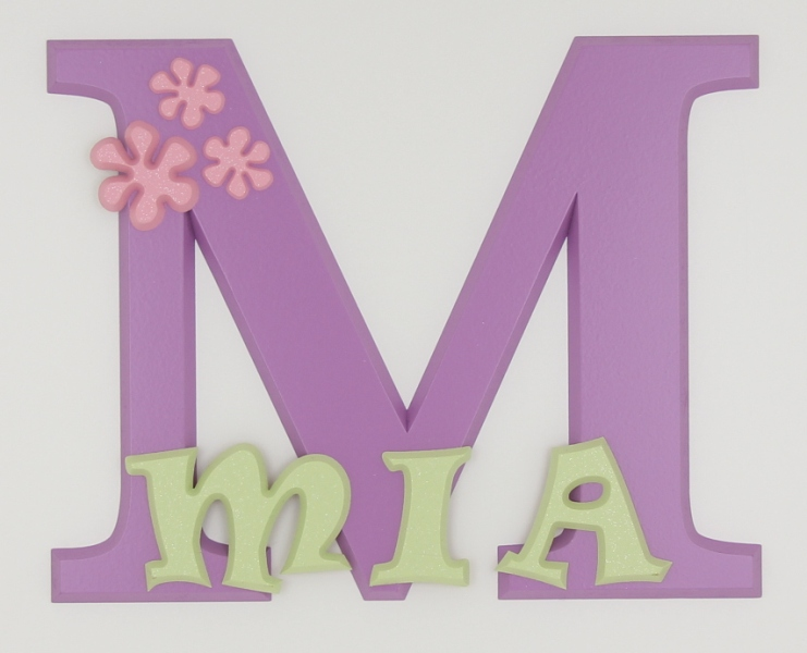 painted wooden name sign for Mia
