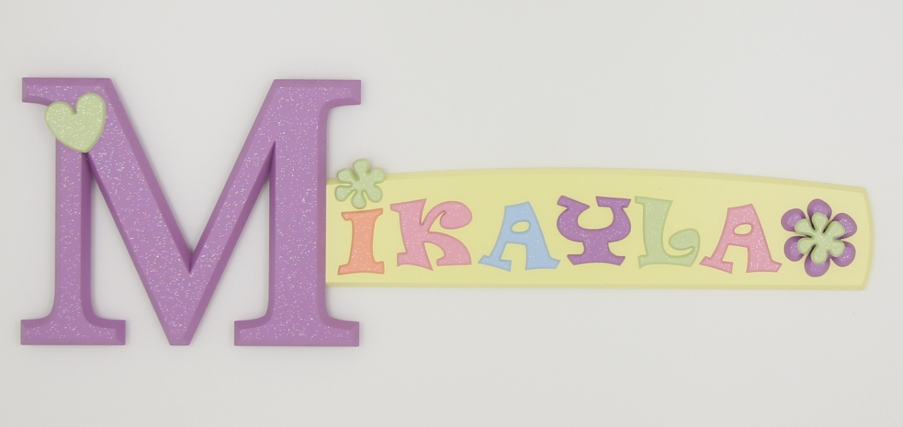 painted wooden name sign for Mikayla