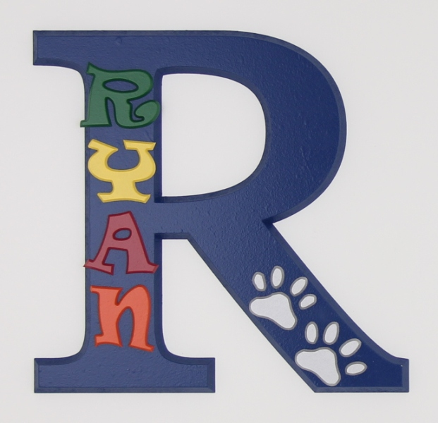 painted wooden name sign for Ryan