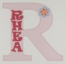 painted wooden name sign for Rhea